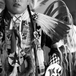 Young aboriginal man dressed in traditional dress for powwow