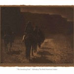 Antique sepia toned photograph of Indian men on horses riding away on a trail