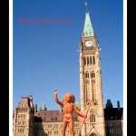 Toy figurine of Indian man in headdress and holding a shield and spear in foreground, Canada's Parliament Buildings and Clocktower in background