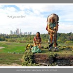Toy figurine of Indian Couple in foreground, green park, grass covered lawns and urban cityscape with skyscrapers in background