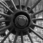 detail of the spokes and hub of hay rake wheel