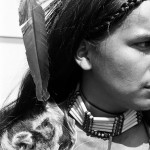 Close up of face shot of young aboriginal man dressed in traditional dress for powwow